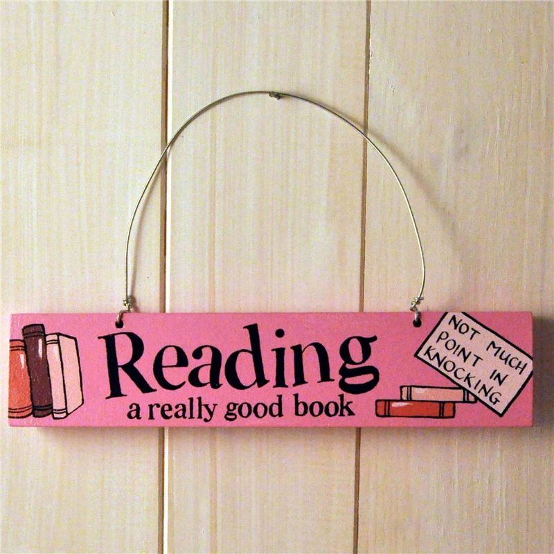 Order Hand Painted Wooden Door Sign:  Reading a really good book (pink)