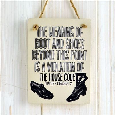 Wooden Hanging Sign The wearing of boots and shoes